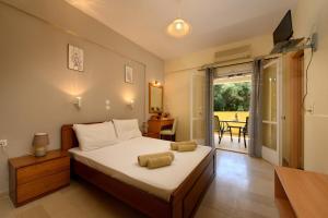 Ένα ή περισσότερα κρεβάτια σε δωμάτιο στο Πενσιόν Έλενα