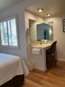 A bathroom at Carmel Resort Inn