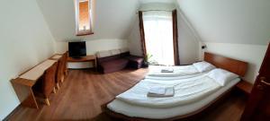 Ein Bett oder Betten in einem Zimmer der Unterkunft Relax Penzion U Adama