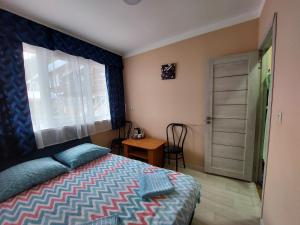 A bed or beds in a room at Malinovka Inn
