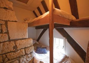 A bunk bed or bunk beds in a room at The Buttery