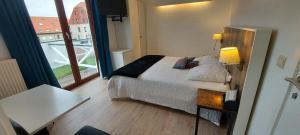 Een bed of bedden in een kamer bij Hotel La Cascada