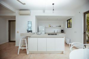 A kitchen or kitchenette at Akwa Resorts Ocean View