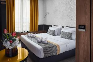A bed or beds in a room at Hotel Panoramika Design & Spa