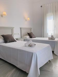 Cama o camas de una habitación en Hotel Doña Blanca