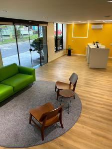 A seating area at ibis Styles Belem Batista Campos
