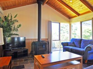 A seating area at ARCHIES BEACHSIDE ABODE - PET FRIENDLY (OUTSIDE ONLY)