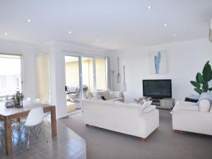 A seating area at SANDPIPER 3 - CLOSE TO BEACH AND TOWN
