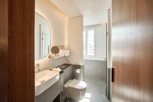 Een badkamer bij Wanderlust, The Unlimited Collection by Oakwood (SG Clean)
