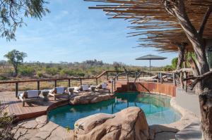 The swimming pool at or close to Jock Safari Lodge
