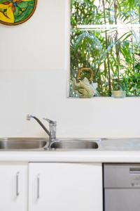 A kitchen or kitchenette at Waterfront Apartment Brimming with Inspirational Artwork