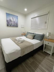 A bed or beds in a room at Crows Nest Tourist Park