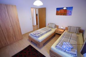 Ein Bett oder Betten in einem Zimmer der Unterkunft Zimmervermietung Liesingtal
