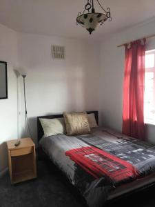 A bed or beds in a room at VERY CHEAP ROOMS ideal for Budget Travellers