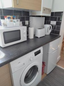 A kitchen or kitchenette at Penge West Retreat