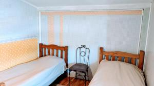A bed or beds in a room at White Shino Hostel