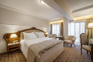 A bed or beds in a room at Residence City Garden
