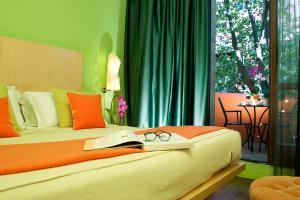 Un ou plusieurs lits dans un hébergement de l'établissement Hotel Abitart