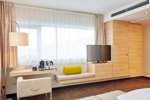 A television and/or entertainment center at H+ Hotel Salzburg