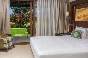 A bed or beds in a room at Bel Jou Adults Only - All Inclusive