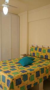 A bed or beds in a room at Apartamento Meia Preia