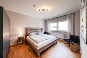A bed or beds in a room at Münster Apartment