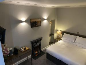 A bed or beds in a room at SPA HOTEL - Deluxe room- Stewart