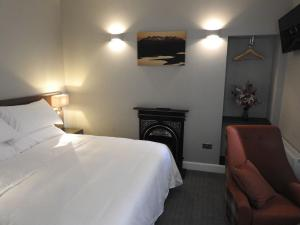 A bed or beds in a room at SPA HOTEL - Classic room - McElwain