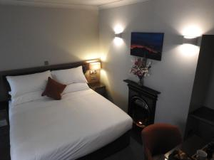 A bed or beds in a room at SPA HOTEL - Classic room - Brunton
