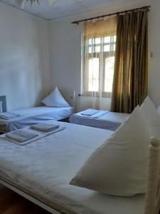 Кровать или кровати в номере Гостевой Дом Петровка