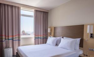 Кровать или кровати в номере Park Inn by Radisson Volgograd Hotel
