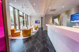 The lobby or reception area at prizeotel Antwerp-City