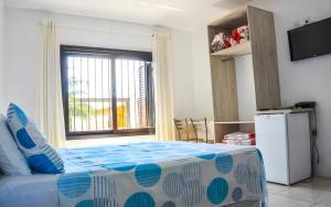 Cama ou camas em um quarto em Classe Hotel & Pousada