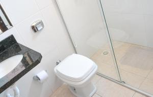 Um banheiro em Classe Hotel & Pousada