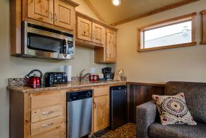 A kitchen or kitchenette at Explorer Cabins at Yellowstone