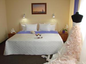 A bed or beds in a room at Podmoskovye Podolsk