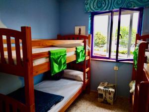 A bunk bed or bunk beds in a room at Albergue Llanes Playa de Poo