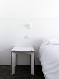A bed or beds in a room at Bela Muxía