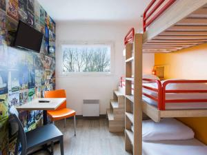 A bunk bed or bunk beds in a room at hotelF1 Maurepas