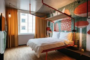 A bed or beds in a room at Superbude Wien Prater