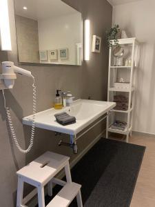Een badkamer bij Guesthouse de Loft