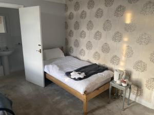 A bed or beds in a room at The Star Inn