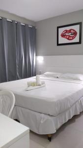 Cama ou camas em um quarto em Plattinum Hotel