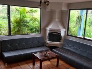A seating area at Casa Galeria Guatape