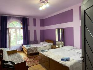 A bed or beds in a room at Areguni Guest House