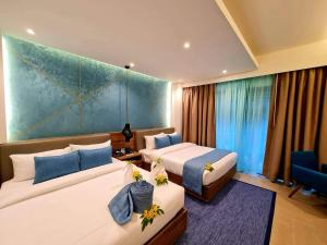 A bed or beds in a room at Fairways and Bluewater Boracay