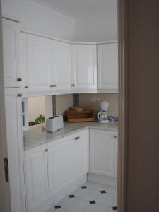 Una cocina o zona de cocina en Alto Golf Apartments