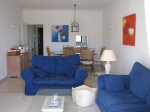 Zona de estar de Alto Golf Apartments