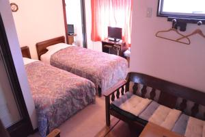 A bed or beds in a room at Hotel Sejour Mint