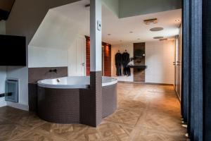 Een badkamer bij Luxexcellent Exclusieve B&B